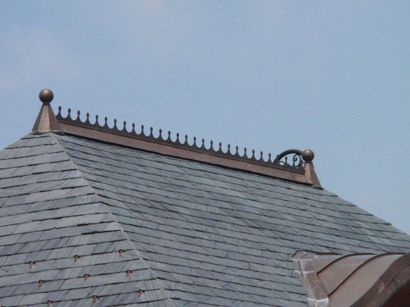Tall Ball and Base Finial Installed on Slate Roof With Alpine Snow Guards and Large Ball Cresting