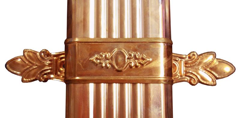 Ornamental Stamped Downspout Bracket - bent & applied